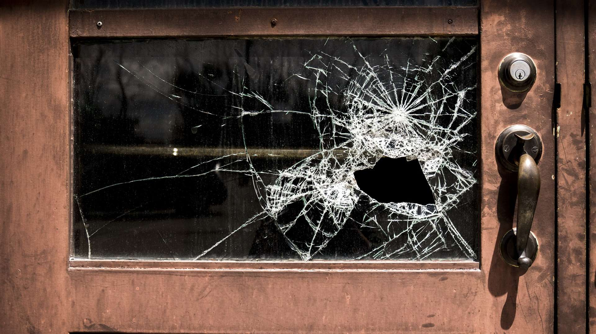 Broken window in a school door